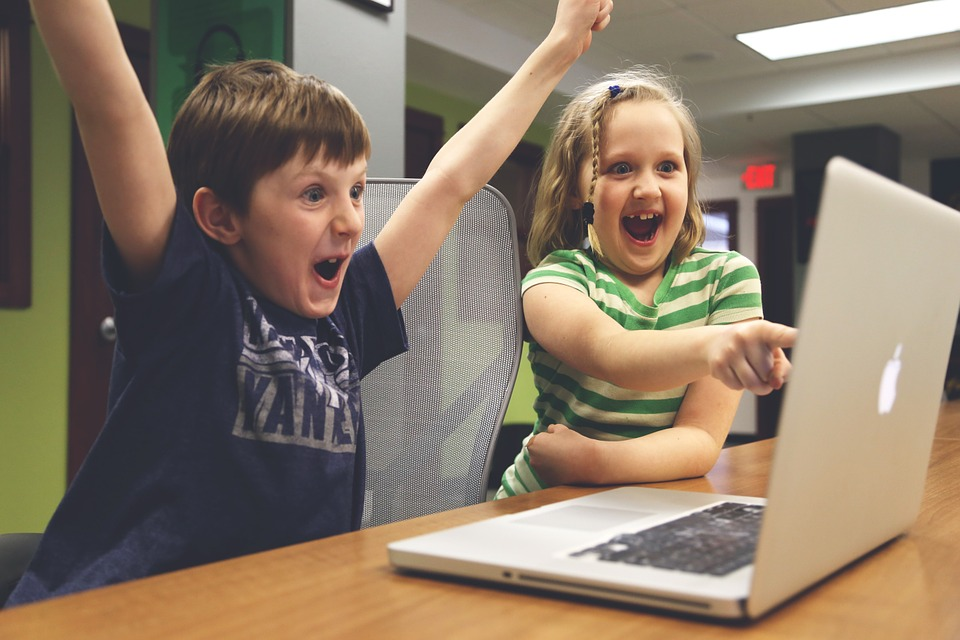 Happy kids responding to a great email marketing campaign
